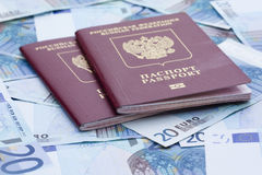 Some euro banknotes and russian passport. Isolated on the table Royalty Free Stock Image