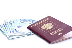 Some euro banknotes and russian passport. Isolated on a white background Royalty Free Stock Image