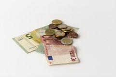 Some euro cash. Banknotes and coins - on a white background royalty free stock photography