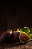 Some figs. Close up view of fresh figs on color back Royalty Free Stock Images