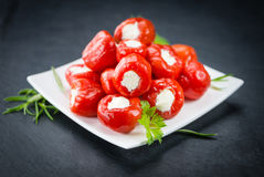 Some Filled Pimientos on a dark slate slab. Portion of Filled Pimientos as detailed close up shot on a slate slab selective focus Royalty Free Stock Image