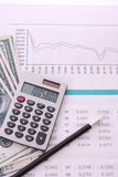 Some financial things. Calculator, money, digits, charts Royalty Free Stock Image