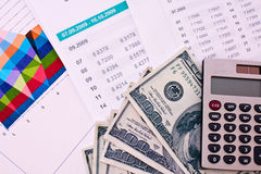 Some financial things. Calculator, money, digits, charts Stock Photos