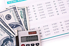 Some financial things. Calculator, money, digits, charts Royalty Free Stock Photos