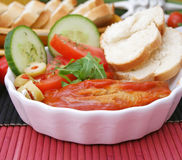 Some fish. In tomato-sauce with salad and bread Stock Images