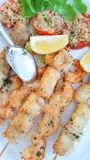 Some fish skewers with shrimp and swordfish baked in the oven Royalty Free Stock Image