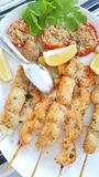 Fish skewers with shrimp and swordfish baked in the oven Stock Photo