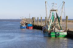Fishing boats in the harbour, Nordstrand, Schleswig-Holstein, Ge. Some fishing boats in the harbour at Nordstrand, Schleswig-Holstein, Germany stock image