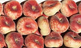 Some flat peaches. Image of some flat peaches at street market Royalty Free Stock Images