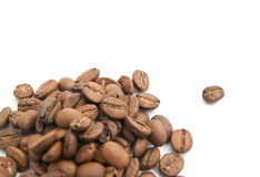 Some flavored coffee beans. Some coffee beans closeup on white background Royalty Free Stock Photography