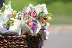 Some flower bouquets. In a wattled basket, street sale of flowers royalty free stock images