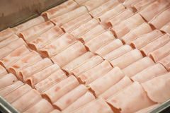 Some folded ham. Is in water and metal contenedor Royalty Free Stock Image