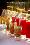 Some food and drinks. In glasses on the table Royalty Free Stock Photo