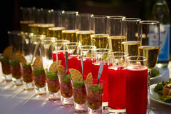 Some food and drinks. In glasses on the table Royalty Free Stock Photos