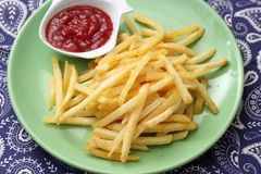 French fries with ketchup. Some french fries with a ketchup of tomatoes royalty free stock images