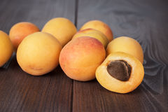Some fresh apricots on brown table. Some fresh apricots over brown wooden background stock photography