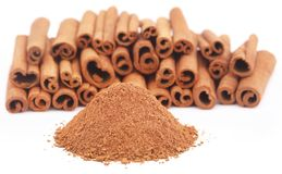 Some fresh aromatic cinnamon with powder spice. Over white background Stock Photo