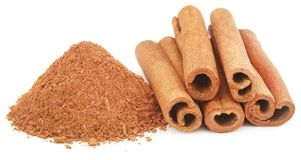 Some fresh aromatic cinnamon with powder spice. Over white background Royalty Free Stock Photography
