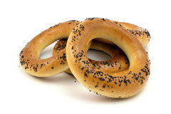 Some fresh bagels. With poppy seeds on a white background Royalty Free Stock Photo