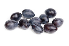 Some fresh blue plums on the white Royalty Free Stock Image