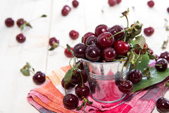 Some fresh Cherries. On bright wooden background Royalty Free Stock Images
