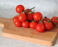 Some fresh cherry tomatoes. On a desk Royalty Free Stock Image