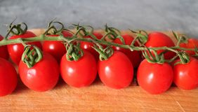 Some fresh cherry tomatoes. On marble background royalty free stock images