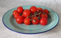 Some fresh cherry tomatoes. On a plate Stock Images