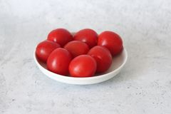 Some fresh cherry tomatoes. On a plate stock image