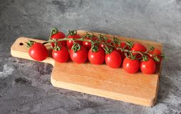 Some fresh cherry tomatoes. On marble background stock image