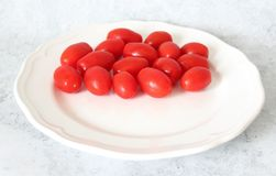 Some fresh cherry tomatoes. On a plate Royalty Free Stock Photo