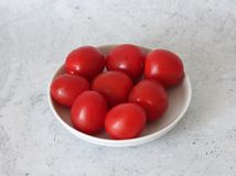 Some fresh cherry tomatoes. On a plate royalty free stock images