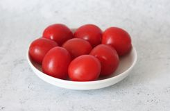 Some fresh cherry tomatoes. On a plate stock photos