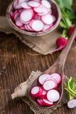 Some fresh chopped Radishes. (close-up shot) on wooden background stock image