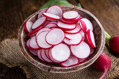 Some fresh chopped Radishes. (close-up shot) on wooden background Stock Images