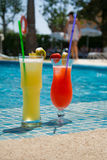 Some fresh cocktails on the pool. Two sweet cocktails are standing at the pool on the spanish summer vacation Royalty Free Stock Photography