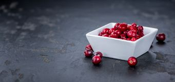 Some fresh Cranberries preserved selective focus; close-up sh. Portion of Preserved Cranberries as detailed close-up shot; selective focus Stock Photos