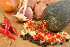 Some fresh crushed organic spices. And spices and pestlpestle Royalty Free Stock Photos