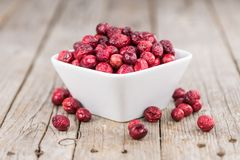 Some fresh Dried Cranberries on wooden background selective foc. Dried Cranberries on an old wooden table selective focus Stock Photos