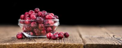 Some fresh Dried Cranberries on wooden background selective foc. Dried Cranberries on an old wooden table selective focus Royalty Free Stock Photography
