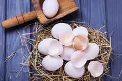 Some fresh eggs. Some fresh white raw eggs in studio on wooden background stock photos