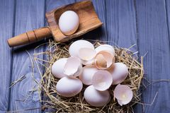 Some fresh eggs. Some fresh white raw eggs in studio on wooden background Royalty Free Stock Photos