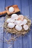 Some fresh eggs. Some fresh white raw eggs in studio on wooden background Stock Photo
