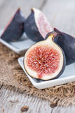 Some fresh Figs. On wooden background Royalty Free Stock Photo