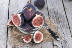 Some fresh Figs. On wooden background royalty free stock images