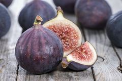 Some fresh Figs. On wooden background Stock Photos
