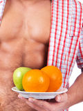 Some fresh fruit.Studio Shot. Young man with some fresh fruits Royalty Free Stock Photos