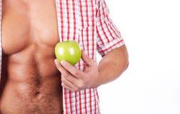 Some fresh fruit. Studio Shot. Young man with fresh green apple Stock Photos