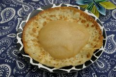 Pancakes. Some fresh homemade pancakes with a puree of apples Royalty Free Stock Image