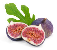 Some fresh,juicy figs. Some fresh figs with green leaves on white Stock Photography